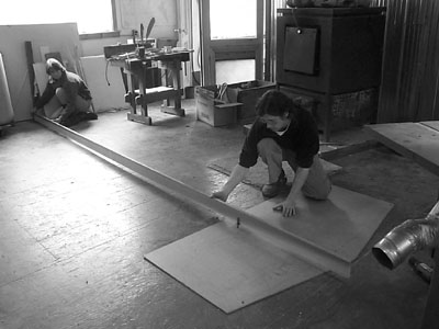 Todd and his beautiful assistant (and wife), Kathy, laying out the radii of the desk using a 15 foot (approximately) beam compass.