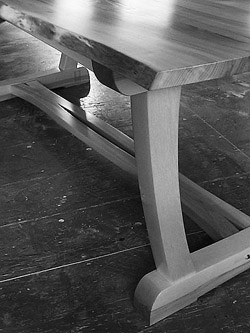 Arts and Crafts Table detail, showing natural edge of top and graceful curves of the supporting structure